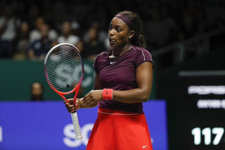Sloane Stephens of the United States reacts while competing against Elina Svitolina of the Ukraine during their women's singles match at the WTA tennis finals in Singapore, Sunday, Oct. 28, 2018. (AP Photo/Vincent Thian)
