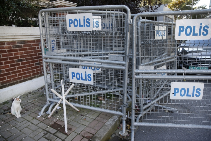 Security barriers block the road leading to Saudi Arabia's consulate in Istanbul, Sunday, Oct. 28, 2018. Saudi Arabia's attorney general is scheduled to arrive in Turkey on Sunday to hold talks with investigators looking into the slaying of Saudi writer Jamal Khashoggi, who was killed in the kingdom's Istanbul consulate earlier this month. (AP Photo/Lefteris Pitarakis)
