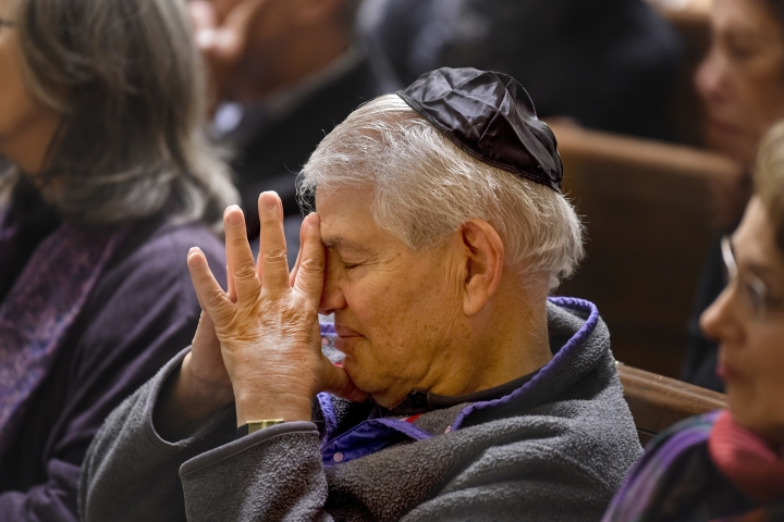 Clifford Pearlman, of Center City, is among the hundreds attending an Interfaith Vigil of Solidarity and Hope at Rodeph Shalom in Philadelphia on Sunday, Oct. 28, 2018, in commemoration of the anti-Semitic attack at the Tree of Life Synagogue in Pittsburgh. The vigil was hosted by the Jewish Federation of Greater Philadelphia. (Tom Gralish/The Philadelphia Inquirer via AP)