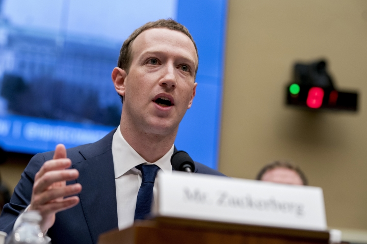 FILE - In this April 11, 2018, file photo, Facebook CEO Mark Zuckerberg testifies before a House Energy and Commerce hearing on Capitol Hill in Washington about the use of Facebook data to target American voters in the 2016 election and data privacy. Facebook Inc. reports earnings Tuesday, Oct. 30. (AP Photo/Andrew Harnik, File)