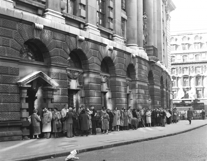 """FILE - In this Oct. 27, 1960 file photo, a queue forms outside The Old Bailey Central Criminal Court, in London, for admission to the public gallery where the """"Lady Chatterley's Lover"""" case is resuming. A paperback copy of """"Lady Chatterley's Lover"""" used by the judge in the U.K. obscenity trial of the novel's publisher has sold at auction for 56,250 pounds ($72,000), more than three times its pre-sale estimate. The tattered Penguin paperback _ along with a damask bag designed to stop photographers snapping the judge with the scandalous tome _ sold to an anonymous bidder at Sotheby's in London on Tuesday, Oct. 30, 2018. (AP Photo, File)"""