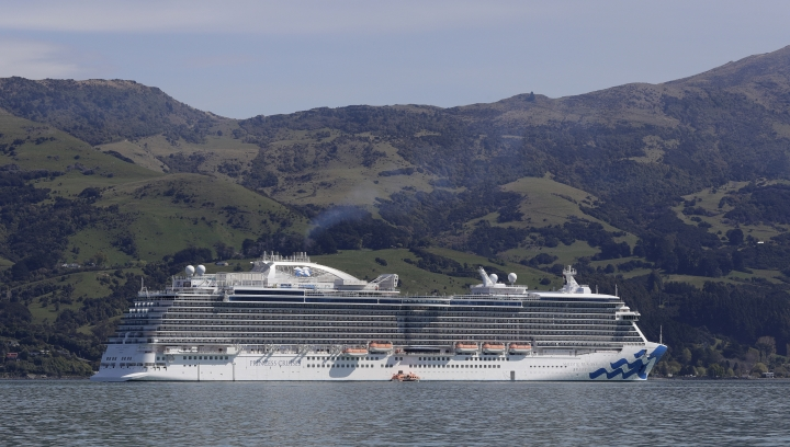 In this Oct. 2, 2018 photo, cruise ship the Majestic Princess at anchor in Akaroa Harbour, in the South Island of New Zealand. With concern rising about the impact of tourism on the environment, New Zealand on Thursday, Nov. 1, 2018, launched a new campaign to try to get visitors to dispose of their litter in bins and otherwise take care of the country. (AP Photo/Mark Baker)