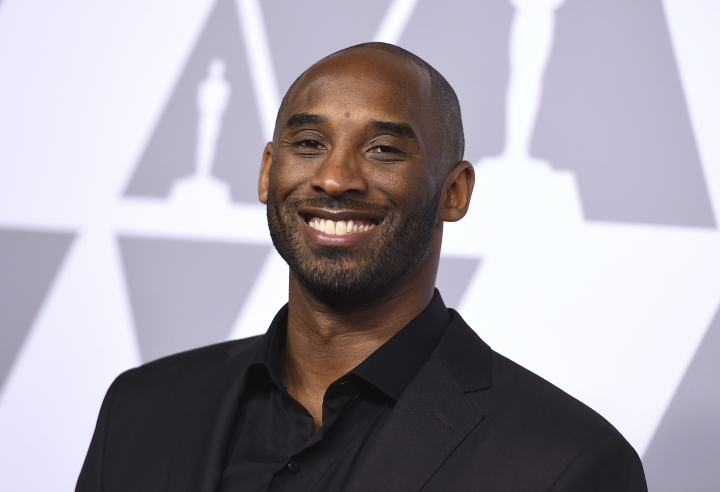 FILE - In this Feb. 5, 2018 file photo, Kobe Bryant arrives at the 90th Academy Awards Nominees Luncheon in Beverly Hills, Calif. Bryant's Granity Studios plans to release five middle grade and young adult novels in 2019 and 2020. (Photo by Jordan Strauss/Invision/AP, File)