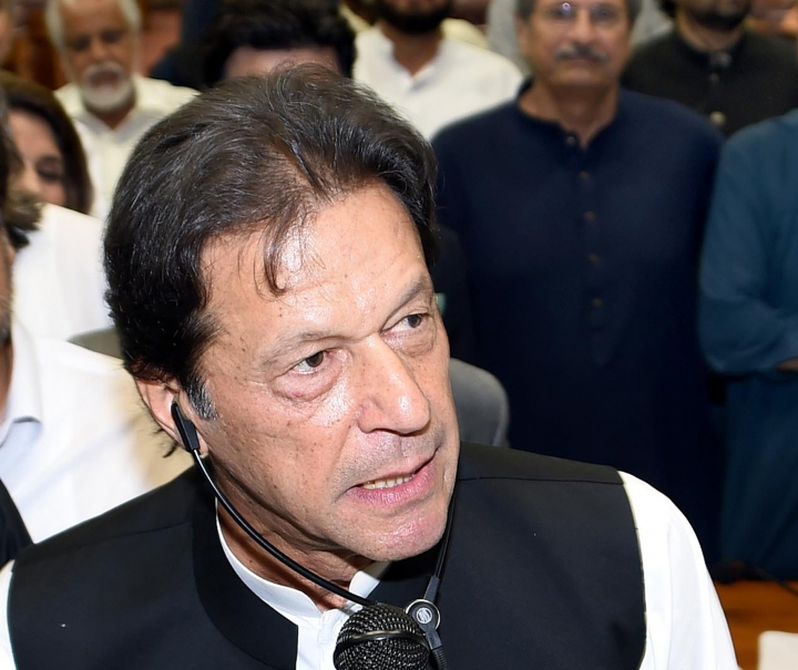 FILE - In this Aug. 17, 2018, file photo released by the National Assembly, the leader of Pakistan Tahreek-e-Insaf party Imran Khan, speaks at the National Assembly in Islamabad, Pakistan. Pakistan's new Prime Minister Khan and China's President Xi Jinping were preparing to meet on Friday, Nov. 2, 2018, amid concerns over Pakistan's growing fiscal crisis and its ability to repay Chinese loans granted as part of Xi's Belt and Road initiative. (National Assembly, via AP, File)