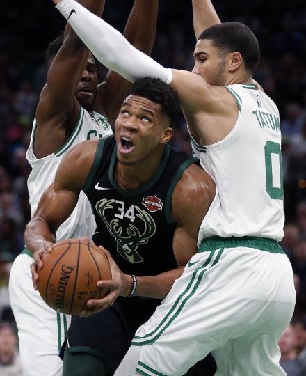 Boston Celtics' Semi Ojeleye, left, and Jayson Tatum (0) double-team Milwaukee Bucks' Giannis Antetokounmpo (34) during the first half of an NBA basketball game in Boston, Thursday, Nov. 1, 2018. (AP Photo/Michael Dwyer)