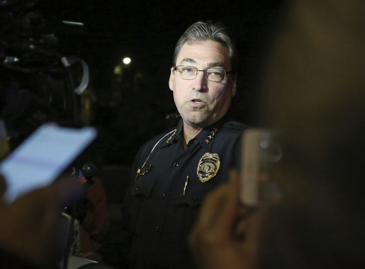 Tallahassee police chief Michael DeLeo speaks to the press at the scene of a shooting, Friday, Nov. 2, 2018, in Tallahassee, Fla. A shooter killed one person and critically wounded four others at a yoga studio in Florida's capital before killing himself Friday, officials said. (AP Photo/Steve Cannon)