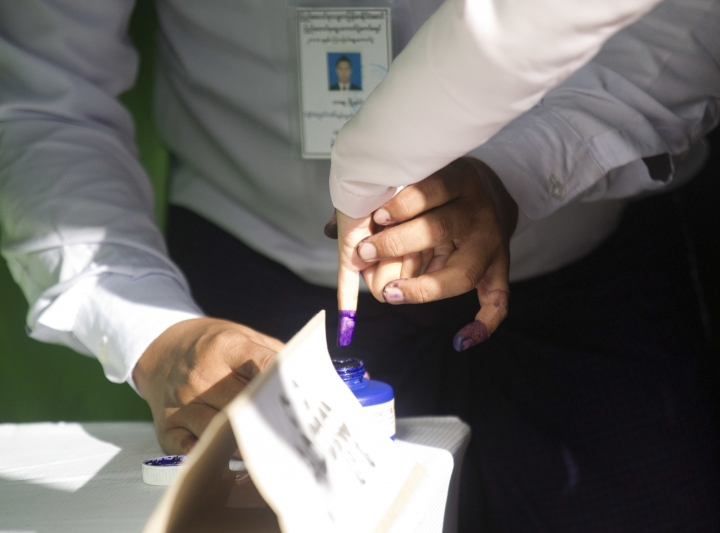A woman marks her finger with ink indicating she voted as she leaves a polling station in Yangon, Myanmar, Saturday, Nov. 3, 2018. Myanmar staged by-elections Saturday in 13 constituencies, a few for the national parliament, the rest at the state or regional levels. (AP Photo/Thein Zaw)