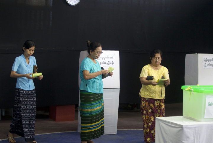 Voters prepare to cast their ballots at a polling station in Yangon, Myanmar, Saturday, Nov. 3, 2018. Myanmar staged by-elections Saturday in 13 constituencies, a few for the national parliament, the rest at the state or regional levels. (AP Photo/Thein Zaw)