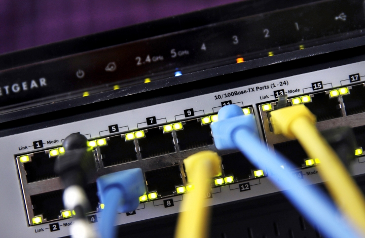 """FILE- In this June 19, 2018, file photo a router and internet switch are displayed in East Derry, N.H. Net neutrality traces back to an engineering maxim called the """"end-to-end principle,"""" a self-regulating network that put control in the hands of end users rather than a central authority. Traditional cable-TV services, for instance, required special equipment and controlled what channels are shown on TV. With an end-to-end network like the internet, the types of equipment, apps, articles and video services permitted are limited only to imagination. (AP Photo/Charles Krupa, File)"""