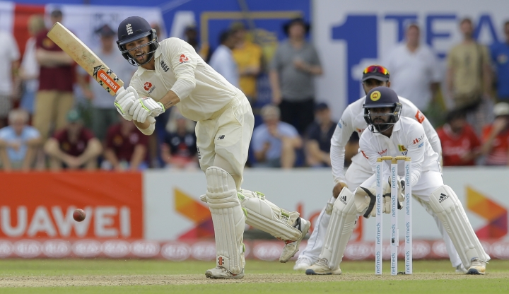 England's Ben Foakes plays a shot during the first day of the first test cricket match between Sri Lanka and England, in Galle, Sri Lanka, Tuesday, Nov. 6, 2018. (AP Photo/Eranga Jayawardena)