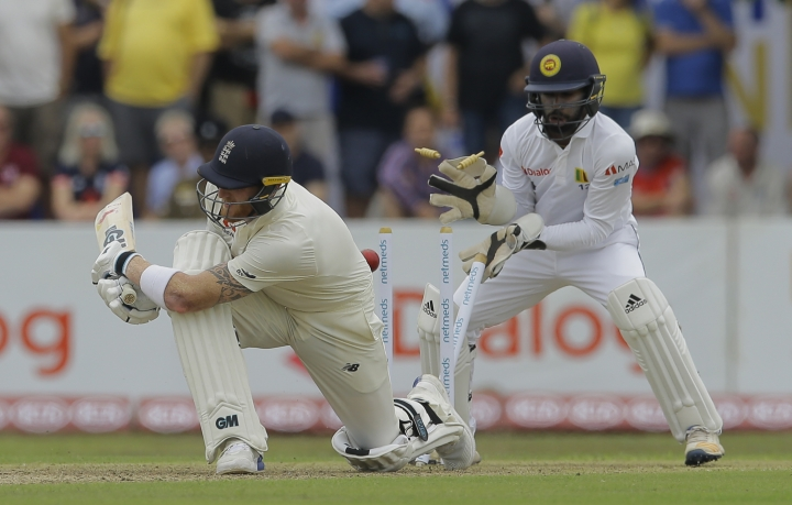 England's Ben Stokes is bowled out as Sri Lankan wicketkeeper Niroshan Dickwella watches during the first day of the first test cricket match between Sri Lanka and England, in Galle, Sri Lanka, Tuesday, Nov. 6, 2018. (AP Photo/Eranga Jayawardena)