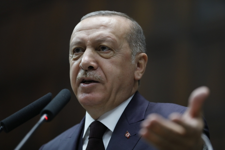Turkey's President Recep Tayyip Erdogan delivers a speech to MPs of his ruling Justice and Development Party (AKP) at the parliament in Ankara, Turkey, Tuesday, Nov. 6, 2018. (AP Photo/Burhan Ozbilici)