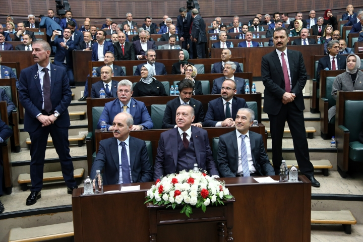 Turkey's President Recep Tayyip Erdogan, centre, sits as waits to deliver a speech to MPs of his ruling Justice and Development Party (AKP) at the parliament in Ankara, Turkey, Tuesday, Nov. 6, 2018. (AP Photo/Burhan Ozbilici)