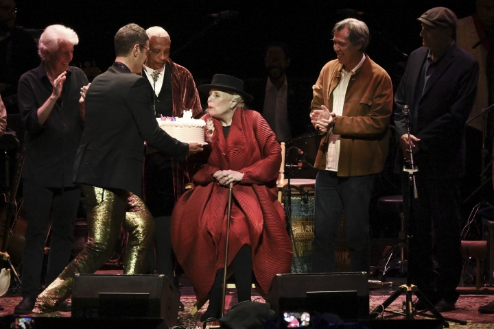 Joni Mitchell is presented with a birthday cake on stage at JONI 75: A Birthday Celebration on Wednesday, Nov. 7, 2018, at the Dorothy Chandler Pavilion in Los Angeles. (Photo by Richard Shotwell/Invision/AP)