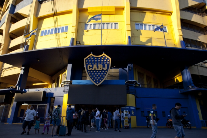 People stand outside Boca Juniors stadium in Buenos Aires, Argentina Wednesday, Nov. 7, 2018. Boca Juniors will face Play River Plate for the Copa Libertadores final match. (AP Photo/Natacha Pisarenko)