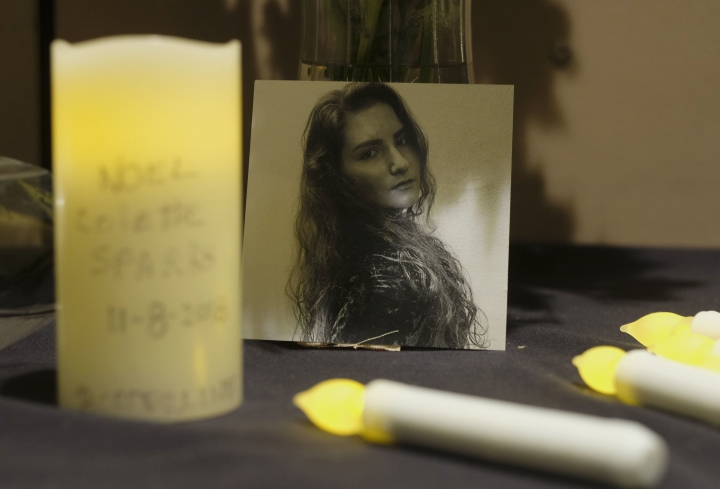 A picture of Noel Sparks is seen during a candlelight vigil in Thousand Oaks, Calif., Thursday, Nov. 8, 2018. A gunman opened fire Wednesday evening inside a country music bar, killing multiple people. (AP Photo/Ringo H.W. Chiu)