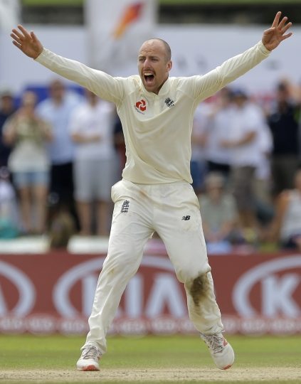 England's Jack Leach successfully appeals to dismiss Sri Lanka's Kaushal Silva during the fourth day of the first test cricket match between Sri Lanka and England in Galle, Sri Lanka, Friday, Nov. 9, 2018. (AP Photo/Eranga Jayawardena)