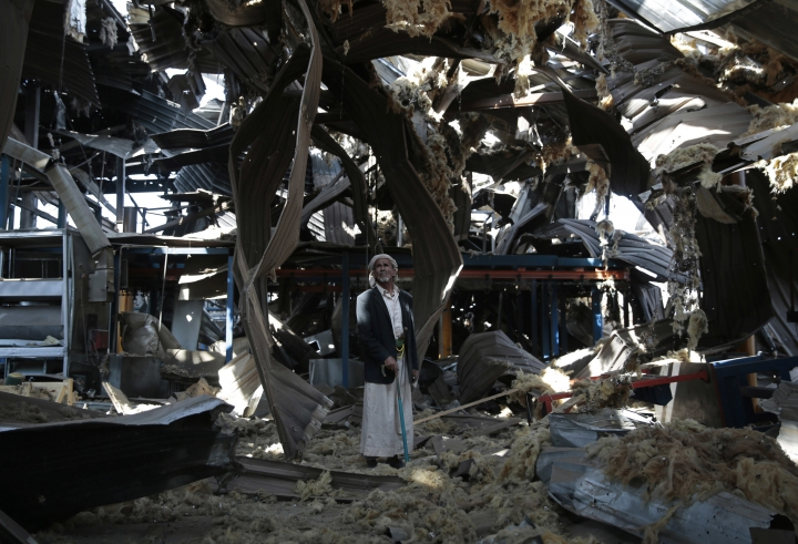 "FILE - In this Sept. 22, 2016, file photo, a man stands among the rubble of the Alsonidar Group's water pump and pipe factory after it was hit by Saudi-led airstrikes in Sanaa, Yemen. The Saudi-led coalition fighting in Yemen said early Saturday, Nov. 10, 2018, it had ""requested cessation of inflight refueling"" by the U.S. for its fighter jets after American officials said they would stop the operations amid growing anger over civilian casualties from the kingdom's airstrikes. (AP Photo/Hani Mohammed, File)"