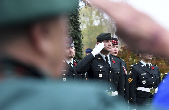 Soldiers attend a War I Centenary service at the St. Symphorien cemetery in Mons, Belgium, Saturday, Nov. 10, 2018. The cemetery contains the graves of the first and last British soldiers killed in the conflict, as well as the last Canadian killed. (AP Photo/Geert Vanden Wijngaert)
