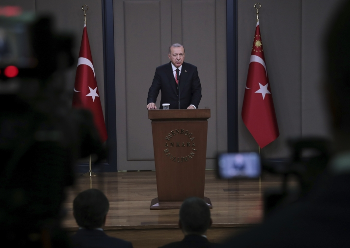 Turkey's President Recep Tayyip Erdogan talks to members of the media at the airport in Ankara, Turkey before departing to France, Saturday, Nov. 10, 2018. Erdogan said at the news conference that officials from Saudi Arabia, the United States, Germany, France and Britain have listened to audio recordings related to the killing of journalist Jamal Khashoggi at the Saudi Consulate in Istanbul. Erdogan's comments were the first public confirmation of the existence of recordings of the Oct. 2 killing of The Washington Post columnist at the consulate. (Presidential Press Service via AP, Pool)