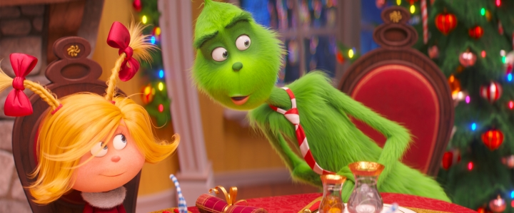 "FILE - This file image released by Universal Pictures shows the characters Cindy-Lou Who, voiced by Cameron Seely, left, and Grinch, voiced by Benedict Cumberbatch, in a scene from ""The Grinch."" ""Dr. Seuss' The Grinch"" made off with $66 million for Universal Pictures to top the weekend North American box office, according to studio estimates Sunday, Nov 11, 2018. (Universal Pictures via AP, File)"