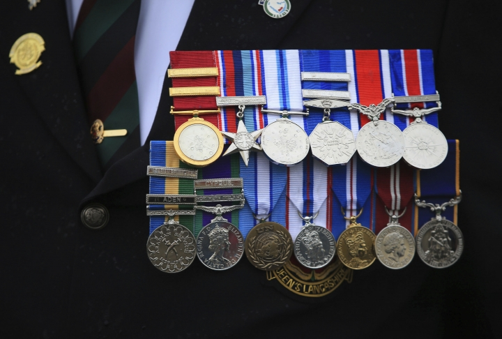 A veteran's medals are worn during a commemorative event to mark the Centennial of the ending of the First World War, in Blackpool, England, Sunday Nov. 11, 2018. The commemorative event marks the 100th anniversary of the signing of the Armistice which ended the First World War. (Danny Lawson/PA via AP)