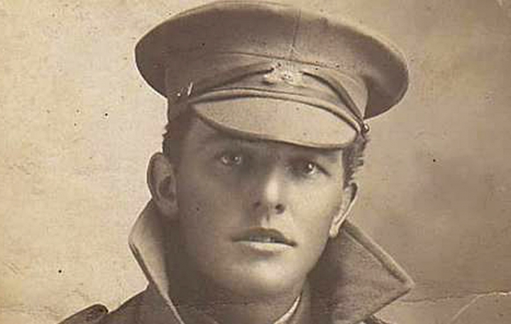Undated handout photo from the Kearsey family made available on Sunday Nov. 11, 2018 of Australian soldier William Kearsay. Shrapnel blasted apart the face of William Kearsey, a World War I soldier fighting in Belgium in Australia's 33rd Battalion. But a friend pulled him from a trench and he survived _ after 28 surgeries to reconstruct his face. Kearsey's son, Peter, was among hundreds lining the rain-soaked Champs-Elysees Avenue in Paris on Sunday to honor along with world leaders those who fought in the Great War 100 years after it ended. (Kearsey Family via AP)