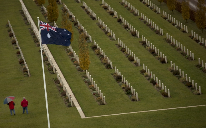 Two visitors walk among the headstones at the World War I Australian National Memorial in Villers-Bretonneux, France, Saturday, Nov. 10, 2018. The memorial walls at the site bear the names of 11,000 missing Australian soldiers who died in France during World War I. (AP Photo/Francisco Seco)
