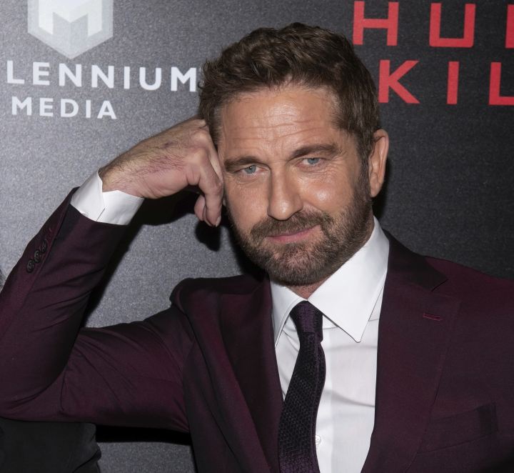 """FILE - In this Monday, Oct. 22, 2018, file photo, Gerard Butler attends the world premiere of """"Hunter Killer,"""" hosted by Lionsgate and The Cinema Society, at the Intrepid Sea, Air and Space Museum in New York. Celebrities, including Butler, whose oceanside homes have been damaged or destroyed in a Southern California wildfire or were forced to flee from the flames expressed sympathy and solidarity with less-famous people hurt worse by the state's deadly blazes, and gave their gratitude to firefighters who kept them safe. (Photo by Charles Sykes/Invision/AP, File)"""