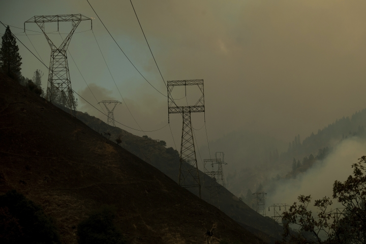 Power transmission lines crest a hilltop above Camp Creek Road, the point of origin of the Camp Fire, in Pulga, Calif., on Sunday, Nov. 11, 2018. (AP Photo/Noah Berger)