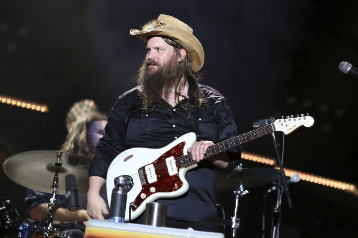 "FILE - In this June 9, 2018 file photo, Chris Stapleton performs at the 2018 CMA Music Festival in Nashville, Tenn. Stapleton's ""Broken Halos"" is nominated for single of the year and song of the year for the Country Music Association Awards. (Photo by Laura Roberts/Invision/AP, File)"