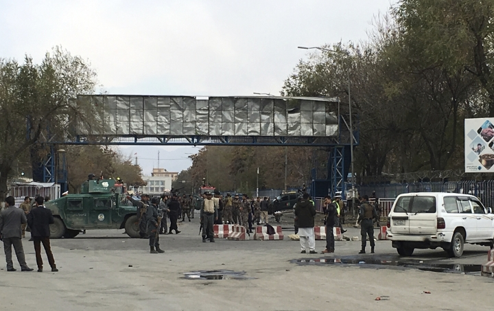 Security forces inspect the site of a suicide attack in the capital of Kabul, Afghanistan, Monday, Nov. 12, 2018. Afghan officials confirm at least three people killed in a blast happened near a high school and the Kabul municipality office while hundreds of people gather to protest against Taliban attacks in Jaghuri and Malistan districts of eastern Ghazni province. (AP Photo/Massoud Hossaini)