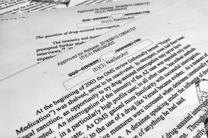 "A portion of a once-classified CIA report that disclosed the existence of a drug research program dubbed ""Project Medication"" is photographed in Washington, Tuesday, Nov. 13, 2018. Shortly after 9/11, the CIA considered using a drug that might work like a truth serum and force terror suspects to give up information about potential attacks. After months of research, the agency decided that a drug called Versed, a sedative often prescribed to reduce anxiety, was ""possibly worth a try."" But in the end, the CIA decided not to ask government lawyers to approve its use. The American Civil Liberties Union fought in court to have the report released. (AP Photo/Jon Elswick)"