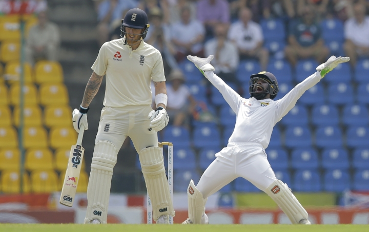 Sri Lanka's Niroshan Dickwella, right, successfully appeals for a leg before decision to dismiss England's Ben Stokes during the first day of the second test cricket match between Sri Lanka and England in Pallekele, Sri Lanka, Wednesday, Nov. 14, 2018. (AP Photo/Eranga Jayawardena)