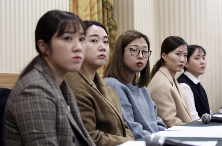 Members of the South Korean Olympic women's curling team listen to questions during a press conference in Seoul, South Korea, Thursday, Nov. 15, 2018. South Korea's hugely popular Olympic curlers have accused their coaches of ruining the team with abusive treatment in a dispute that has spoiled one of the year's feel-good sports stories. (AP Photo/Ahn Young-joon)