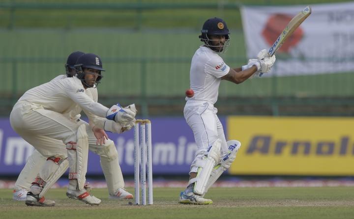Sri Lanka's Roshen Silva plays a shot as England's wicketkeeper Ben Foakes watches during the second day of the second test cricket match between Sri Lanka and England in Pallekele, Sri Lanka, Thursday, Nov. 15, 2018. (AP Photo/Eranga Jayawardena)