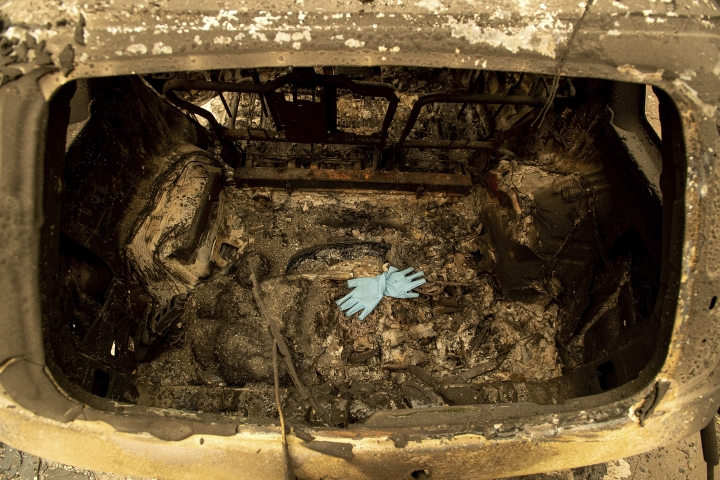 Gloves rest in a scorched car after the Camp Fire burned through Paradise, Calif., on Thursday, Nov. 15, 2018. (AP Photo/Noah Berger)