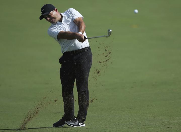 Italy's Francesco Molinari plays a shot on the 1st hole during the first round of the DP World Tour Championship golf tournament in Dubai, United Arab Emirates, Thursday, Nov. 15, 2018. (AP Photo/Kamran Jebreili)