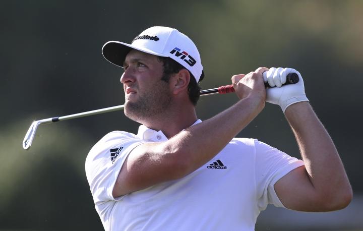 Spain's Jon Rahm follows his ball on the 16th hole during the first round of the DP World Tour Championship golf tournament in Dubai, United Arab Emirates, Thursday, Nov. 15, 2018. (AP Photo/Kamran Jebreili)