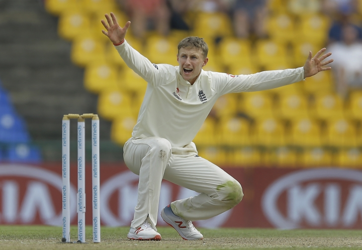 England's captain Joe Root unsuccessfully appeals for the wicket of Sri Lanka's Dilruwan Perera during the second day of the second test cricket match between Sri Lanka and England in Pallekele, Sri Lanka, Thursday, Nov. 15, 2018. (AP Photo/Eranga Jayawardena)