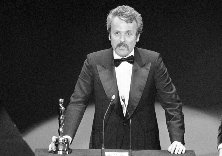 "FILE - In this March 28, 1977 file photo, William Goldman accepts his Oscar at Academy Awards in Los Angeles, for screenplay from other medium for ""All The President's Men."" Goldman, the Oscar-winning screenplay writer of ""Butch Cassidy and the Sundance Kid"" and ""All the President's Men"" William Goldman died, Friday, Nov. 16, 2018. He was 87. (AP Photo, File)"