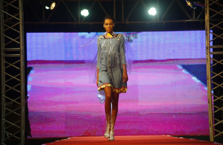 A model presents a creation from Clandestina during a fashion show in Havana, Cuba, Thursday, Nov. 15, 2018. The initiative combines fashion design by Cuban entrepreneurs of the Clandestina brand with the backing of United States tech giant Google that is looking to develop the access to the internet to a country with low connectivity. (AP Photo/Desmond Boylan)