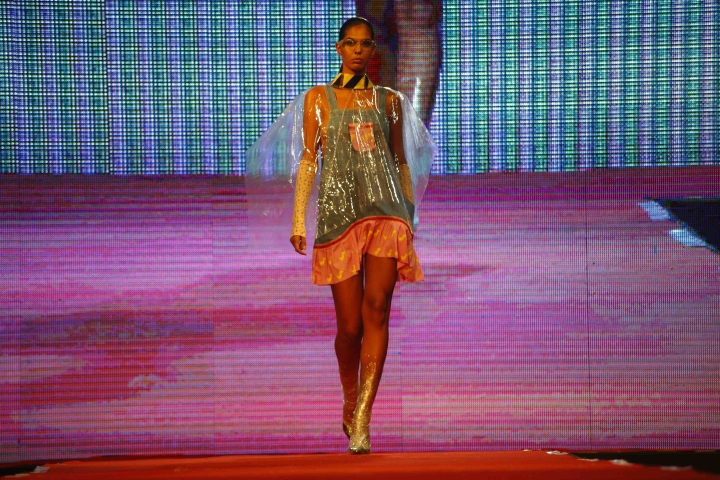 A model presents a creation by Clandestina during a fashion show in Havana, Cuba, Thursday, Nov. 15, 2018. The initiative combines fashion design by Cuban entrepreneurs of the Clandestina brand with the backing of United States tech giant Google that is looking to develop the access to the internet to a country with low connectivity. (AP Photo/Desmond Boylan)