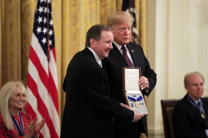 Jack Soden, President and CEO of Elvis Presley Enterprises, accepts the Medal of Freedom on behalf of the Presley family from President Donald Trump during a ceremony in the East Room of the White House in Washington, Friday, Nov. 16, 2018. (AP Photo/Manuel Balce Ceneta)