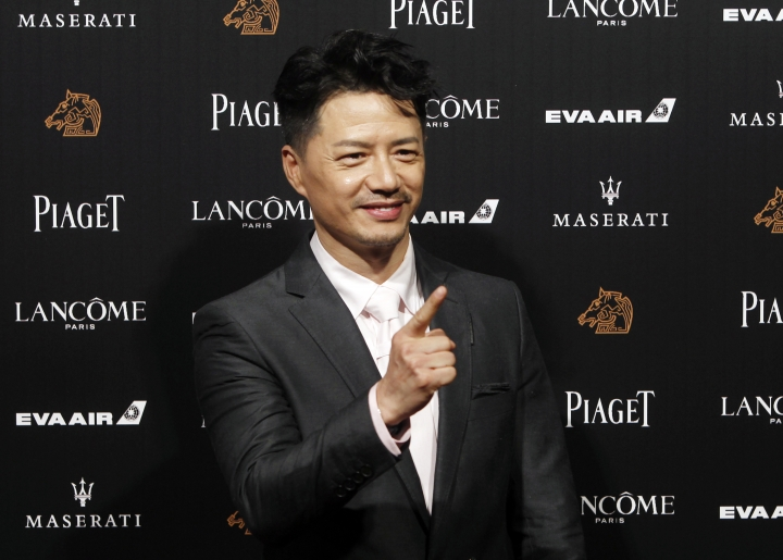 """Chinese actor Duan Yihong arrives at the 55th Golden Horse Awards in Taipei, Taiwan, Saturday, Nov. 17, 2018. Duan is nominated for Best Leading Actor for the film """"The Looming Storm"""" at this year's Golden Horse Awards -one of the Chinese-language film industry's biggest annual events. (AP Photo/Chiang Ying-ying)"""