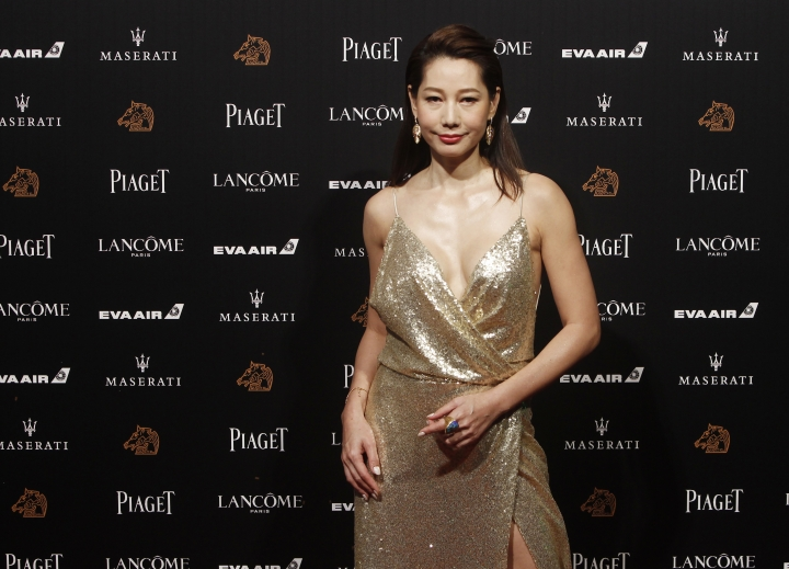 """Taiwanese actress Ding Ning arrives at the 55th Golden Horse Awards in Taipei, Taiwan, Saturday, Nov. 17, 2018. Ding is nominated for Best Supporting Actress for the film """"Cities of Last Things"""" at this year's Golden Horse Awards -one of the Chinese-language film industry's biggest annual events. (AP Photo/Chiang YIng-ying)"""