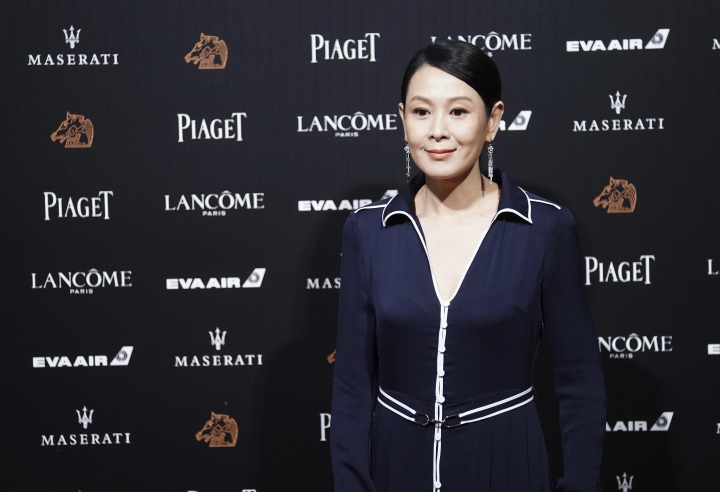 "Taiwanese director Rene Liu arrives at the 55th Golden Horse Awards in Taipei, Taiwan, Saturday, Nov. 17, 2018. Liu is nominated for Best New Director for the film ""Us and Them"" at this year's Golden Horse Awards -one of the Chinese-language film industry's biggest annual events. (AP Photo/Billy Dai)"