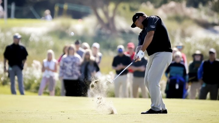 Jason Gore hits a chip shot onto the second green during the third round of the RSM Classic golf tournament on Saturday, Nov. 17, 2018, in St. Simons Island, Ga. (AP Photo/Stephen B. Morton)