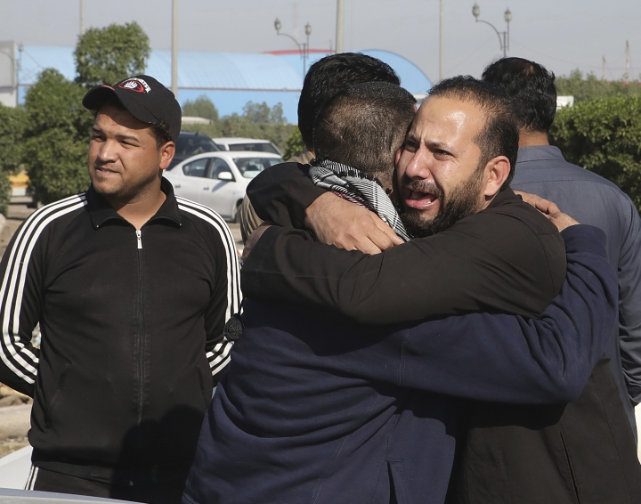 Men mourn the death of prominent social activist Wissam al-Ghrawi in Basra, Iraq, Sunday, Nov. 18, 2018. Iraqi police say religious cleric Wissam, who was linked to the ongoing protests over poor services in Basra, was killed outside his home after suggested that demonstrators should take up arms over the conditions in the city. (AP Photo/Nabil al-Jurani)