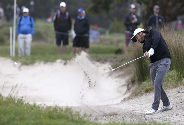 Abraham Ancer of Mexico plays from a fairway bunker on the 8th during the Australian Open Golf tournament in Sydney, Thursday, Nov. 15, 2018. (AP Photo/Rick Rycroft)